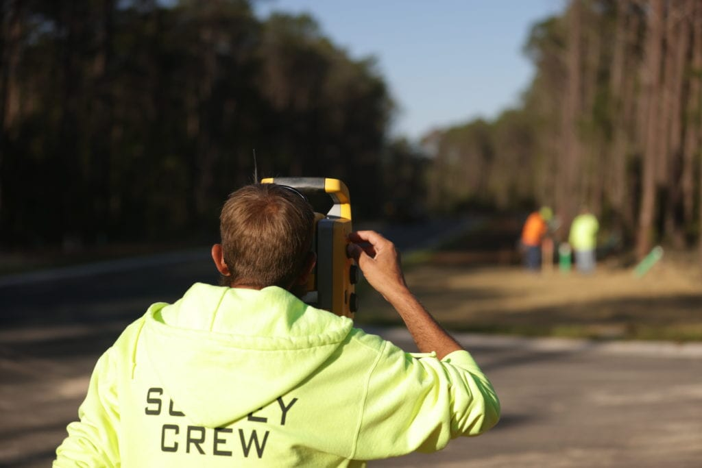 Image of a member of the GCT Surveying team using surveying equipment